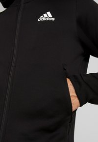 adidas Performance - WARM HOODIE - Sweatjacke - black - 5
