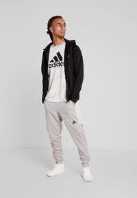 adidas Performance - WARM HOODIE - Sweatjacke - black - 1