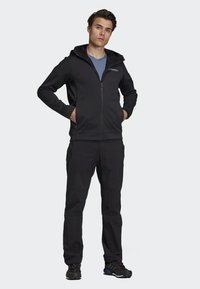 adidas Performance - CLIMAHEAT HOODED FLEECE JACKET - Fleece jacket - black - 1