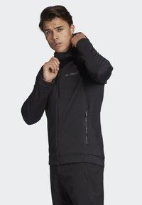 adidas Performance - CLIMAHEAT HOODED FLEECE JACKET - Fleece jacket - black - 4