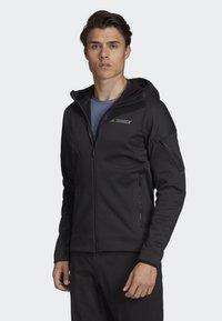 adidas Performance - CLIMAHEAT HOODED FLEECE JACKET - Fleece jacket - black - 3