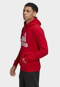 adidas Performance - MUST HAVES BADGE OF SPORT HOODIE - Huppari - red - 2