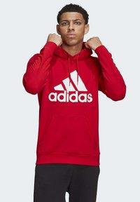 adidas Performance - MUST HAVES BADGE OF SPORT HOODIE - Huppari - red - 3