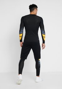 adidas Performance - ALPHASKIN SPORT MOTO COMPRESSION T-SHIRT - Sports shirt - black - 2