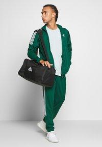 adidas Performance - ATHLETICS TEAM SPORTS TRACKSUIT - Tracksuit - green/white - 1