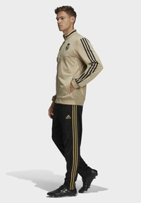 adidas Performance - REAL MADRID SUIT - Pantalon classique - gold - 3
