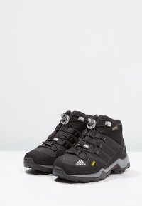 adidas Performance - TERREX MID GTX - Hiking shoes - core black/vista grey - 2