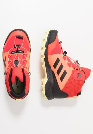 TERREX MID GORE-TEX - Hiking shoes - shock red/core black/yellow tint