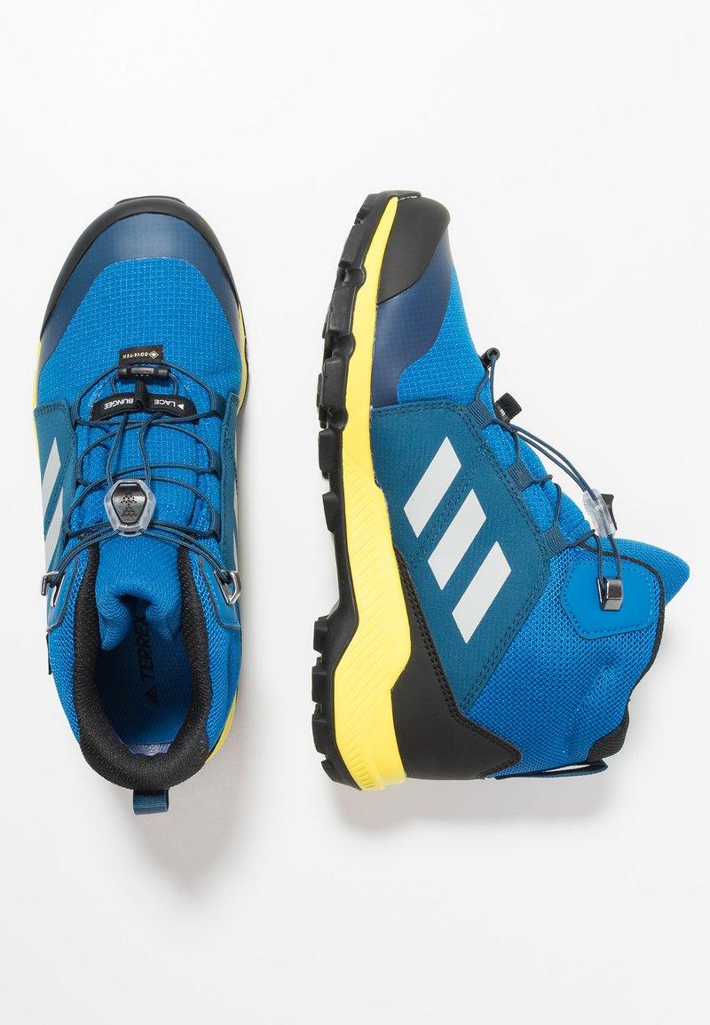 adidas Performance - TERREX MID GTX - Scarpa da hiking -  blue beauty/grey one/shock yellow