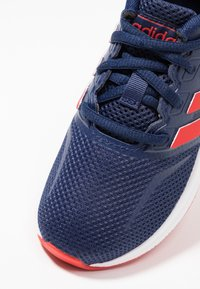 adidas Performance - Scarpe running neutre - dark blue/active red/core black - 2