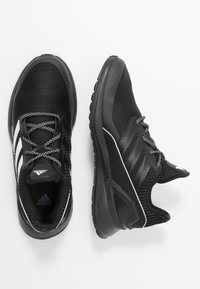 adidas Performance - RAPIDARUN - Chaussures de running neutres - core black/footwear white - 0