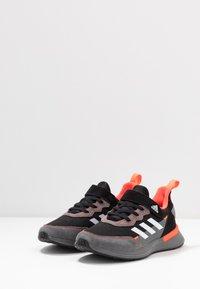 adidas Performance - RAPIDARUN CLOUDFOAM RUNNING SHOES - Neutral running shoes - core black/footwear white/solar red - 3