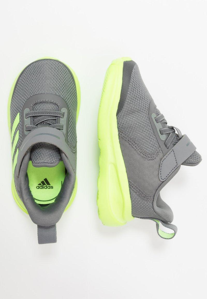 adidas Performance - FORTARUN KIDS NEXT SPORTS SHOES UNISEX - Obuwie do biegania treningowe - grey four/signal green/footwear white