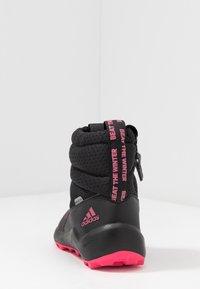 adidas Performance - RAPIDASNOW - Zimní obuv - core black/real pink/footwear white - 4