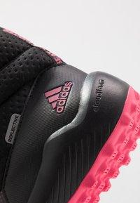 adidas Performance - RAPIDASNOW - Zimní obuv - core black/real pink/footwear white - 2
