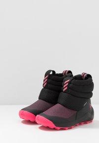 adidas Performance - RAPIDASNOW - Zimní obuv - core black/real pink/footwear white - 3