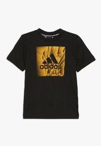 adidas Performance - BOX TEE - T-shirt z nadrukiem - black - 0