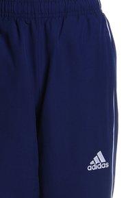 adidas Performance - CORE - Teplákové kalhoty - darkblue/white - 2