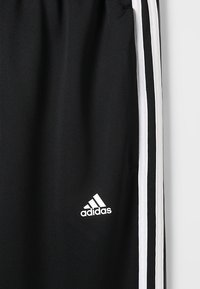 adidas Performance - TIRO STADIUM LEAGUE AEROREADY PANTS - Tracksuit bottoms - black/white - 5