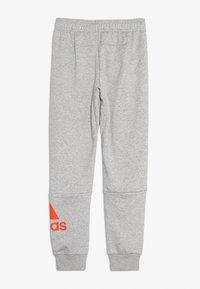 adidas Performance - Pantalon de survêtement - medium grey heather/active orange - 1