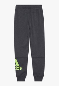 adidas Performance - Tracksuit bottoms - mottled dark grey - 1