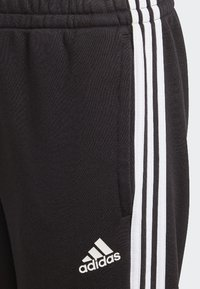 adidas Performance - MUST HAVES TIRO JOGGERS - Pantaloni sportivi - black/white - 3