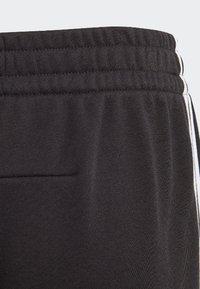 adidas Performance - MUST HAVES TIRO JOGGERS - Trainingsbroek - black/white - 2