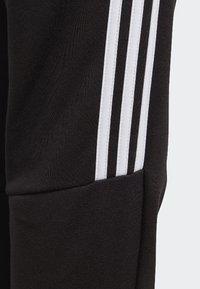 adidas Performance - MUST HAVES TIRO JOGGERS - Pantalon de survêtement - black/white - 4