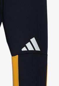 adidas Performance - TIGHT - Leggings - dark blue/yellow - 4