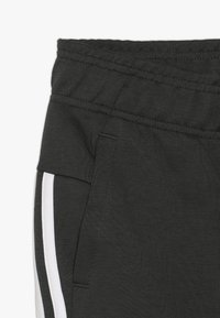 adidas Performance - Pantalon de survêtement - dark green/white - 2
