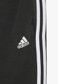 adidas Performance - Pantalon de survêtement - dark green/white - 4