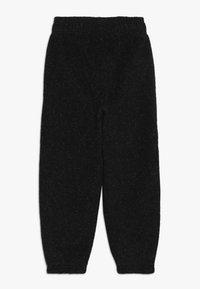 adidas Performance - ID WARM - Tracksuit bottoms - black/white - 1