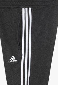 adidas Performance - TIRO 19 - Teplákové kalhoty - black melange/white - 4