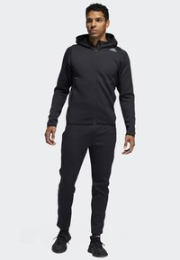 adidas Performance - CLIMAHEAT JOGGERS - Jogginghose - black - 1