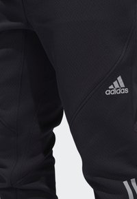 adidas Performance - CLIMAHEAT JOGGERS - Jogginghose - black - 5