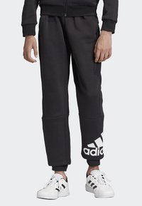 adidas Performance - MUST HAVES BADGE OF SPORT FLEECE JOGGERS - Tracksuit bottoms - black - 0