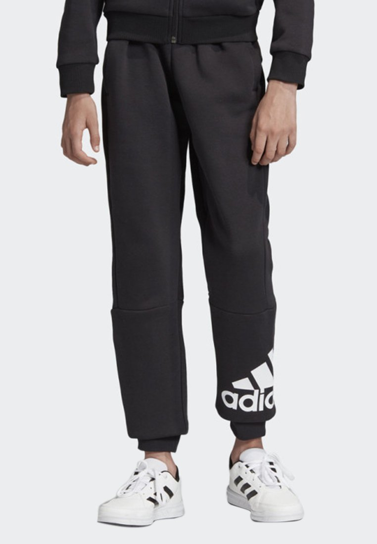 adidas Performance - MUST HAVES BADGE OF SPORT FLEECE JOGGERS - Tracksuit bottoms - black