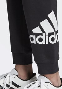 adidas Performance - MUST HAVES BADGE OF SPORT FLEECE JOGGERS - Tracksuit bottoms - black - 4