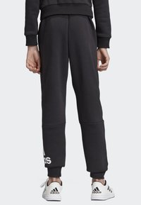 adidas Performance - MUST HAVES BADGE OF SPORT FLEECE JOGGERS - Tracksuit bottoms - black - 2