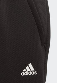 adidas Performance - CLIMAWARM TAPERED JOGGERS - Tracksuit bottoms - black - 3