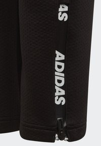 adidas Performance - CLIMAWARM TAPERED JOGGERS - Tracksuit bottoms - black - 2