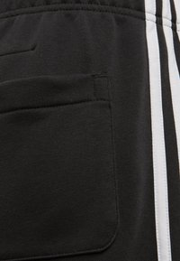 adidas Performance - MUST HAVES 3-STRIPES SHORTS - Sports shorts - black - 3
