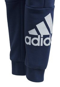adidas Performance - MUST HAVES JOGGERS - Tracksuit bottoms - tech indigo - 2