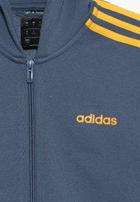 adidas Performance - Hoodie met rits - blue-grey/yellow - 4