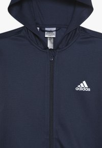 adidas Performance - Chaqueta de entrenamiento - collegiate navy/vivid red/white - 4