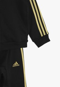 adidas Performance - HOLIDAY - Chándal - black/gold - 3