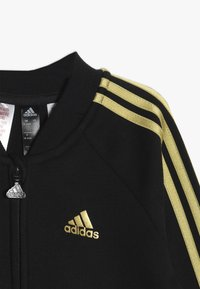 adidas Performance - HOLIDAY - Chándal - black/gold - 4