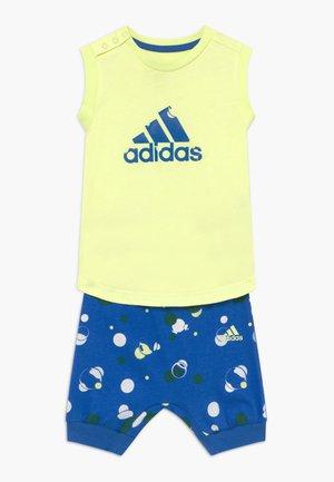 SET  - Sports shorts - yellow/blue