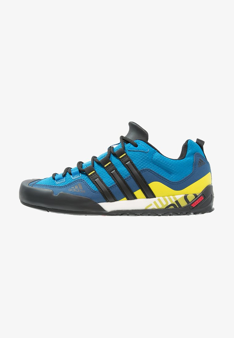 adidas Performance - TERREX SWIFT SOLO - Hiking shoes - unity blue/core black/unity lime