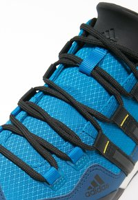 adidas Performance - TERREX SWIFT SOLO - Hiking shoes - unity blue/core black/unity lime - 5